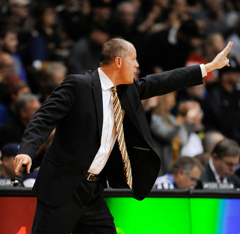 . Colorado University head coach, Tad Boyle, along the bench during the game against Kansas at the Coors Events Center in Boulder Colorado Saturday afternoon, December 07, 2013. (Photo By Andy Cross/The Denver Post)