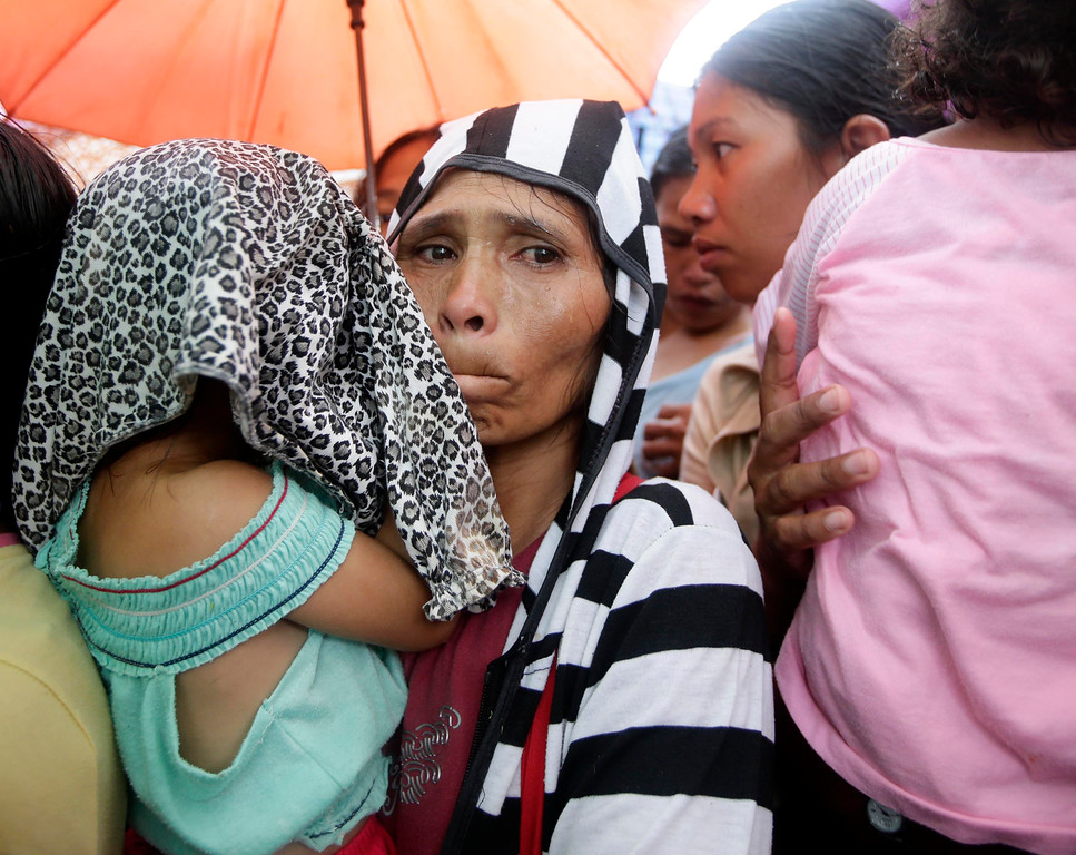 . Residents queue up to receive cash handouts given by the government in quake-hit Sagbayan township, Bohol province in central Philippines Thursday Oct.17, 2013.  (AP Photo/Bullit Marquez)