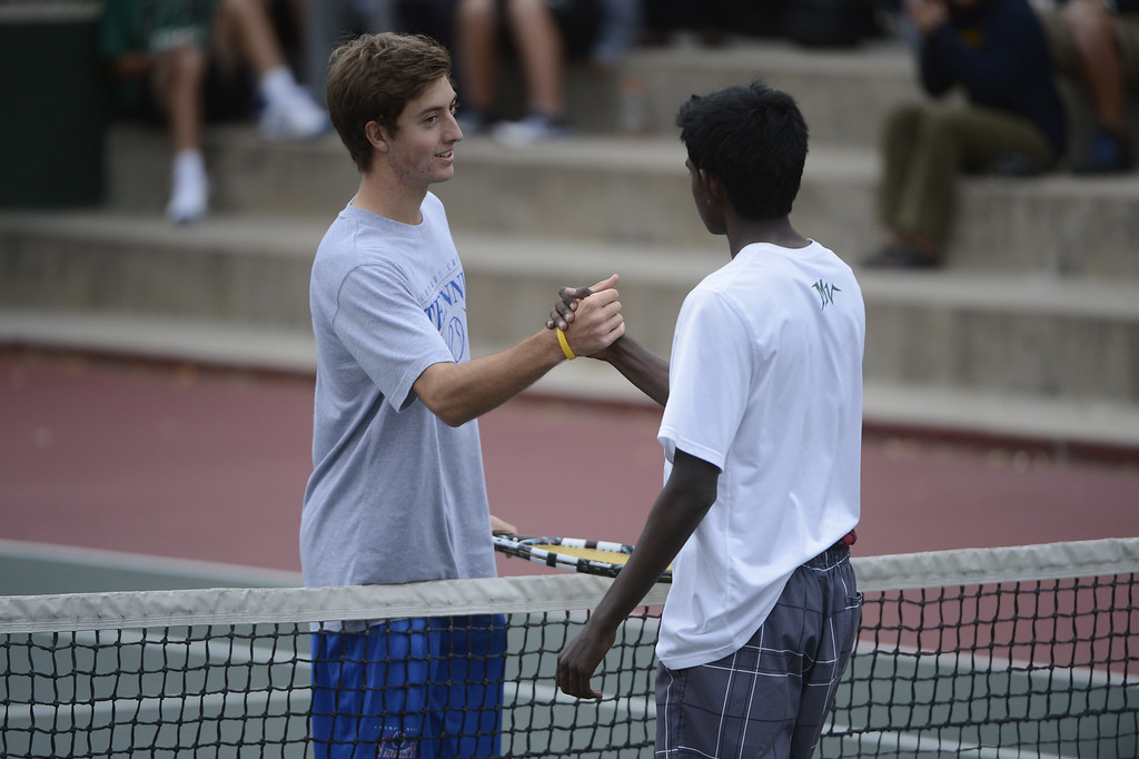 . DENVER, CO - OCTOBER 11:  Zach Fryer, Cherry Creek High School, left, acknowledges opponent,Vignesh Senthivel, Mountain Vista  High School, after defeating Senthivel for their #1 semi-final match at the 2013 State 5A Tennis Championships at the Gates Tennis Center in Denver, Colorado Friday morning, October 11, 2013. (Photo By Andy Cross/The Denver Post)