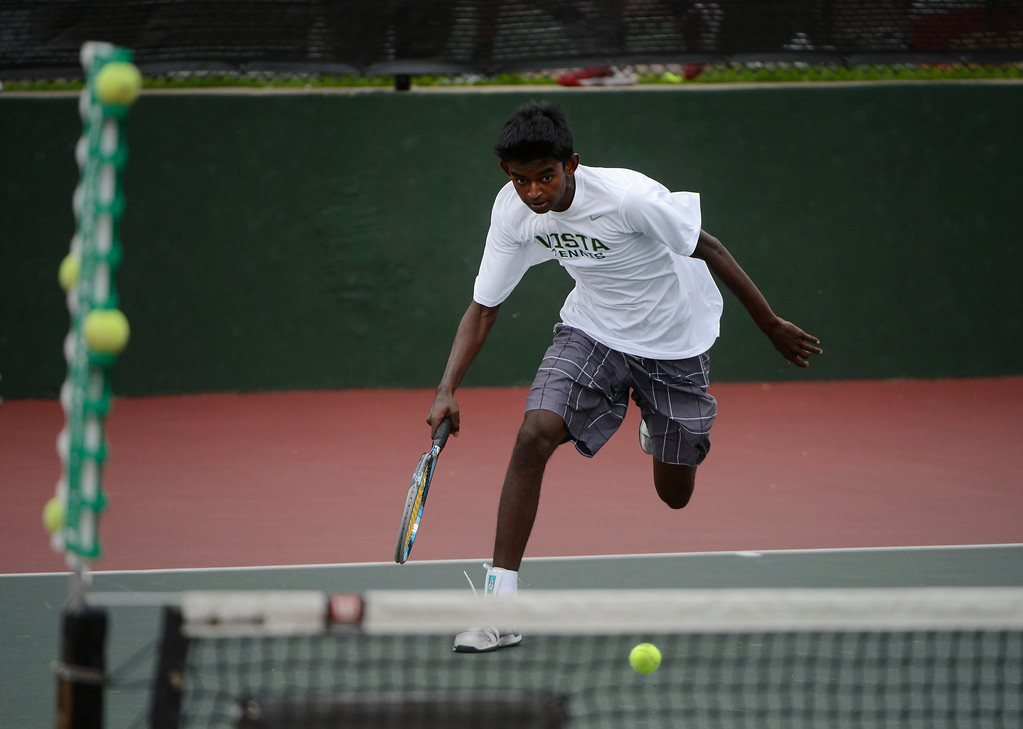 . DENVER, CO - OCTOBER 11:   Vignesh Senthivel, Mountain Vista  High School, runs after the ball near the net shot by opponent, Zach Fryer, Cherry Creek High School, (not pictured) during their #1 semi-final match at the 2013 State 5A Tennis Championships at the Gates Tennis Center in Denver, Colorado Friday morning, October 11, 2013. (Photo By Andy Cross/The Denver Post)