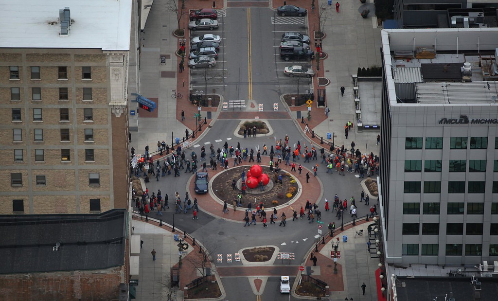 . Protesters to the right-to-work legislation march on the state Capitol in Lansing, Mich., on Tuesday Dec. 11, 2012. Several thousand union members gathered to protest the legislation. (AP Photo/Detroit Free Press, Romain Blanquart)