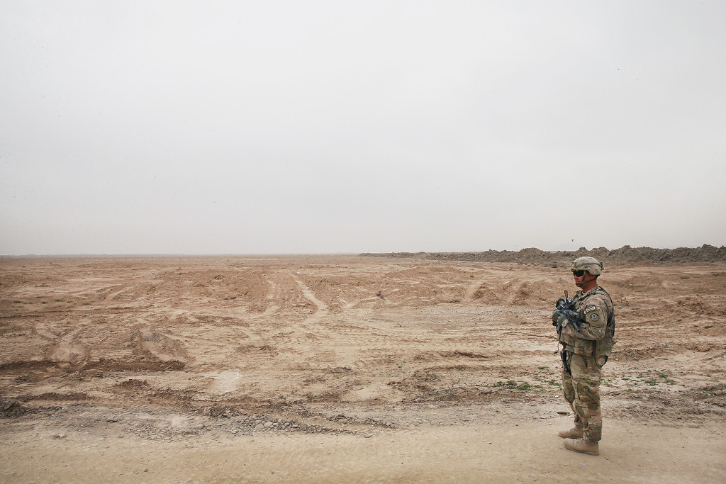 . U.S. Army SGT Matt Farkas from Sierra Vista, Arizona with 4th squadron 2d Cavalry Regiment keeps watch as the unit visits an Afghan National Police (ANP) outpost that was once home to Osama Bin Laden during a patrol on February 25, 2014 near Kandahar, Afghanistan.    (Photo by Scott Olson/Getty Images)