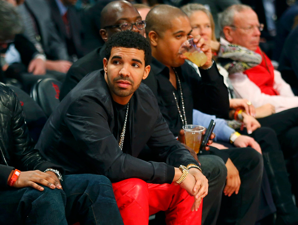 . Rapper Drake looks on before the All Star slam dunk competition during the NBA basketball All-Star weekend in Houston, Texas, February 16, 2013.   REUTERS/Jeff Haynes