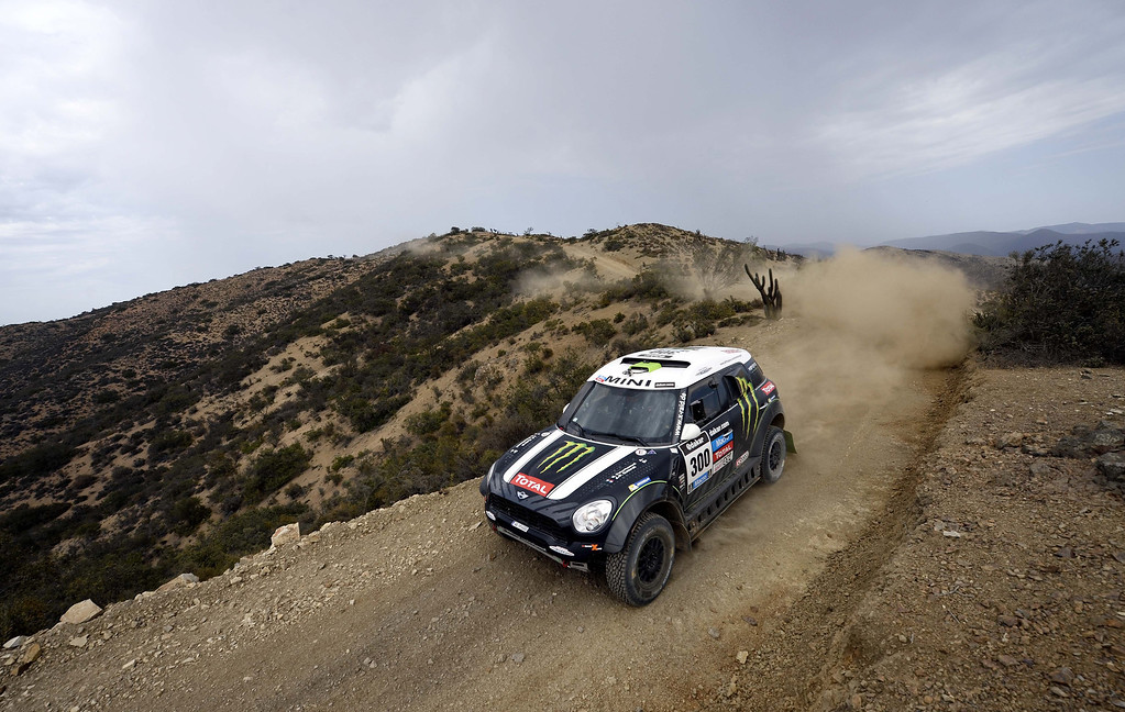 . Mini\'s driver Stephane Peterhansel of France and co-driver Jean Paul Cottret compete during the 2014 Rally Dakar 13th and last stage between La Serena and Valparaiso, Chile, on January 18, 2014. Spains Nani Roma won the Dakar Rally 2014 ahead of France\'s Stephane Peterhansel and Nasser Al-Attiyah of Qatar. FRANCK FIFE/AFP/Getty Images