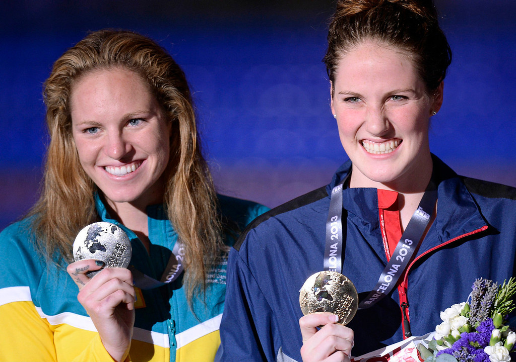 . Missy Franklin of the United States, right, smiles as she holds her gold medal with Australia\'s Emily Seebohm, silver, after the presentation ceremony for the Women\'s 100m backstroke final at the FINA Swimming World Championships in Barcelona, Spain, Tuesday, July 30, 2013. (AP Photo/Manu Fernandez)