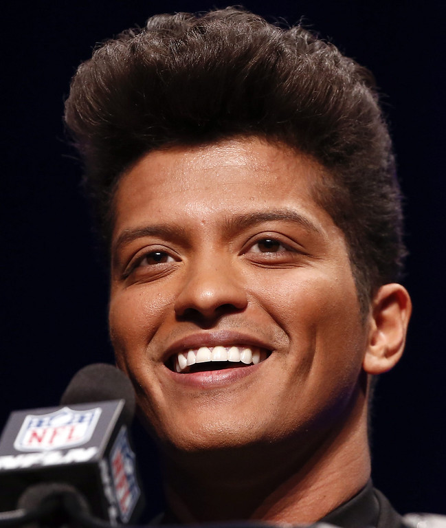 . U.S. pop artist Bruno Mars smiles at a news conference for the Super Bowl LXVIII in New York, New York, USA 30 January 2014.   EPA/TANNEN MAURY