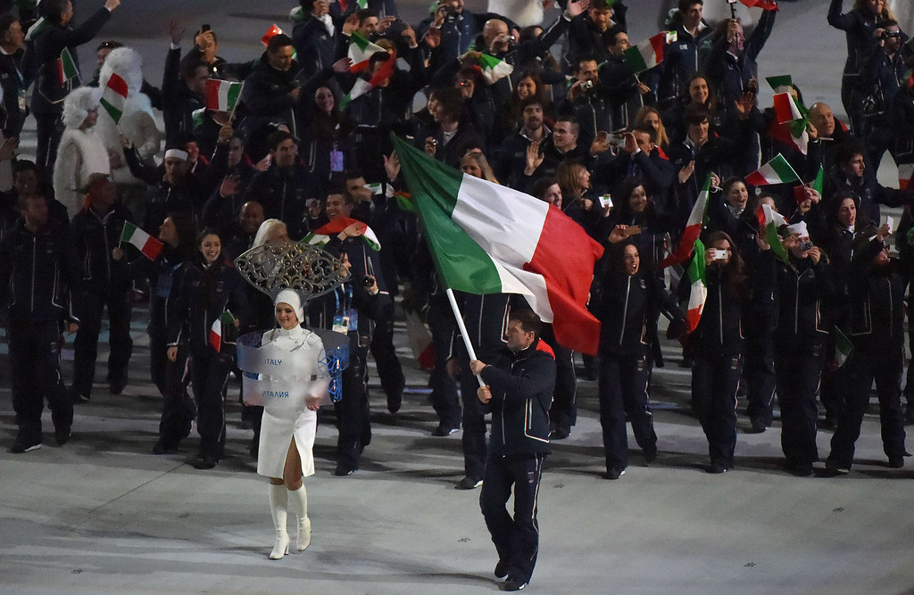 . Italy\'s flag bearer, luger Armin Zoeggeler leads the delegation during the Opening Ceremony of the Sochi Winter Olympics at the Fisht Olympic Stadium on February 7, 2014 in Sochi. AFP PHOTO / DAMIEN MEYER/AFP/Getty Images