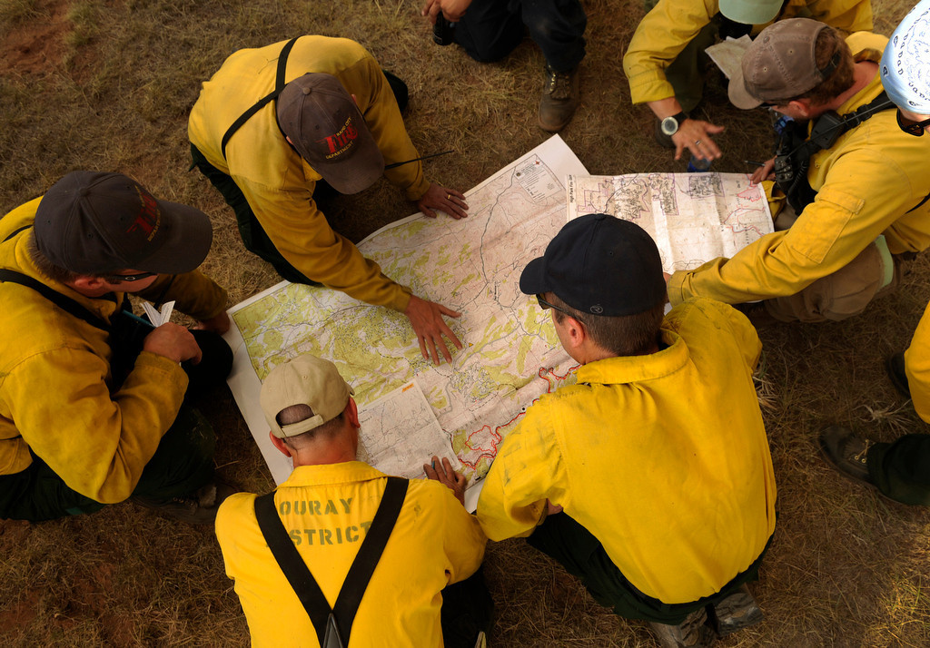 . Firefighters organized their efforts at Livermore before heading uphill to deploy in the Glacier View Meadows subdivsion Friday evening, June 22, 2012. The High Park fire crossed the Poudre River again threatening hundreds of homes to the north. Karl Gehring/The Denver Post