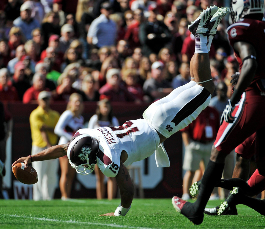 . Mississippi State quarterback Dak Prescott (15) dives for the goal line during the first half of an NCAA college football game against South Carolina, Saturday, Nov. 2, 2013, in Columbia, S.C. Prescott did not score on the play. (AP Photo/Rainier Ehrhardt)