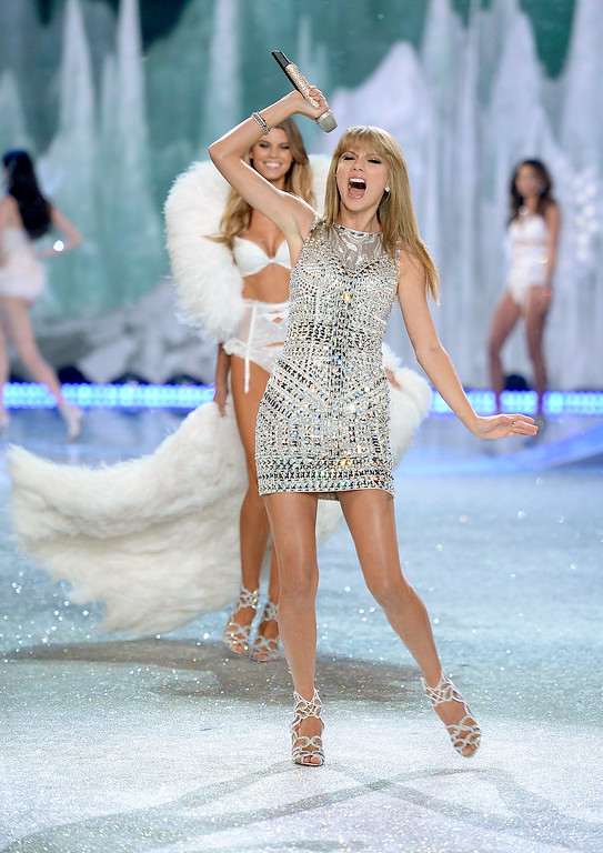 . Singer Taylor Swift performs and model Maryna Linchuk walks the runway at the 2013 Victoria\'s Secret Fashion Show at Lexington Avenue Armory on November 13, 2013 in New York City.  (Photo by Dimitrios Kambouris/Getty Images for Victoria\'s Secret)
