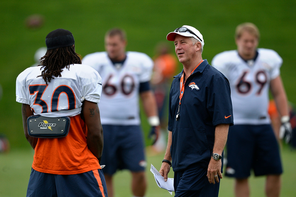 . Denver Broncos head coach John Fox talks with Denver Broncos strong safety David Bruton (30) before the start of day 12 of the Denver Broncos 2014 training camp August 5, 2014 at Dove Valley. (Photo by John Leyba/The Denver Post)