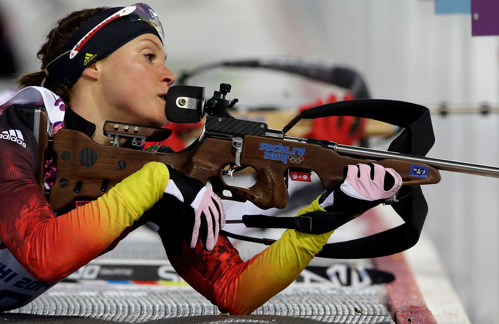 . Germany\'s Evi Sachenbacher-Stehle prepares to shoot during the women\'s biathlon 15k individual race, at the 2014 Winter Olympics, Friday, Feb. 14, 2014, in Krasnaya Polyana, Russia. (AP Photo/Lee Jin-man)