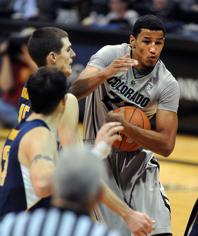 . Andre Roberson goes strong to the basket past David Kravish of Cal during the second  half of the January 27th, 2013 game in Boulder. Cliff Grassmick/The Daily Camera