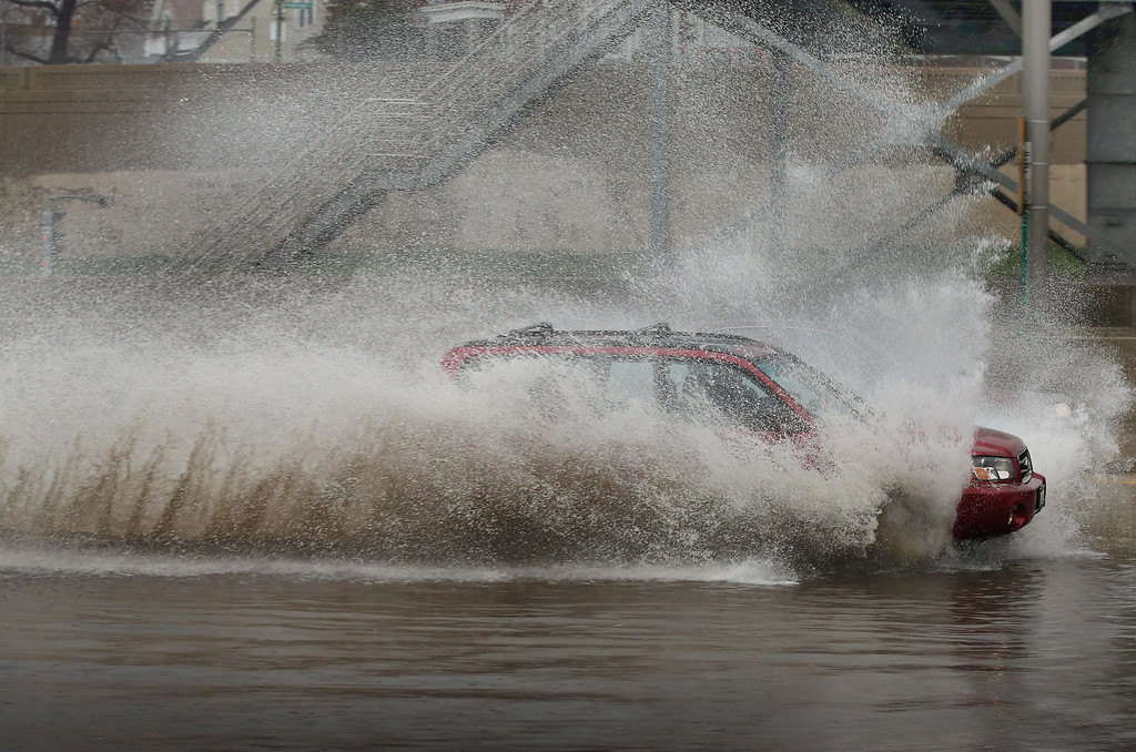 . A motorist drives through a flooded section of the Kennedy Expressway on April 18, 2013 in Chicago, Illinois. Thunderstorms dumped up to 5 inches of rain on parts of the Chicago area overnight, closing sections the Edens, Eisenhower and Kennedy expressways, which lead to and from downtown, during the morning rush.  (Photo by Scott Olson/Getty Images)