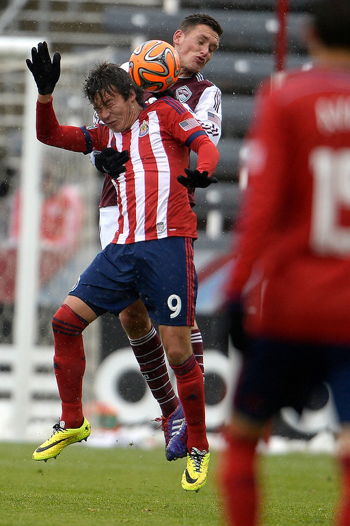 . Erick Torres (9) of Chivas USA and Shane O\'Neill (27) of Colorado Rapids head the ball during the second half. Chivas USA defeated the Colorado Rapids 3-1 on Sunday, May 11, 2014. (Photo by AAron Ontiveroz/The Denver Post)