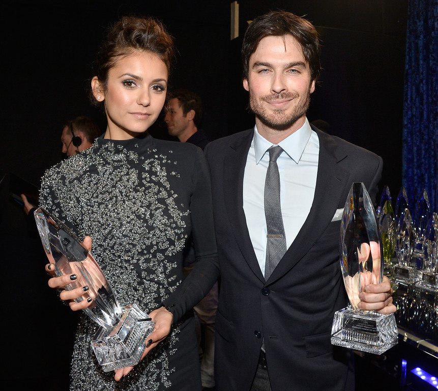". LOS ANGELES, CA - JANUARY 08:  Actors Nina Dobrev (L) and Ian Somerhalder, winners of the Favorite On Screen Chemistry award for ""The Vampire Diaries,\"" attend The 40th Annual People\'s Choice Awards at Nokia Theatre L.A. Live on January 8, 2014 in Los Angeles, California.  (Photo by Frazer Harrison/Getty Images for The People\'s Choice Awards)"