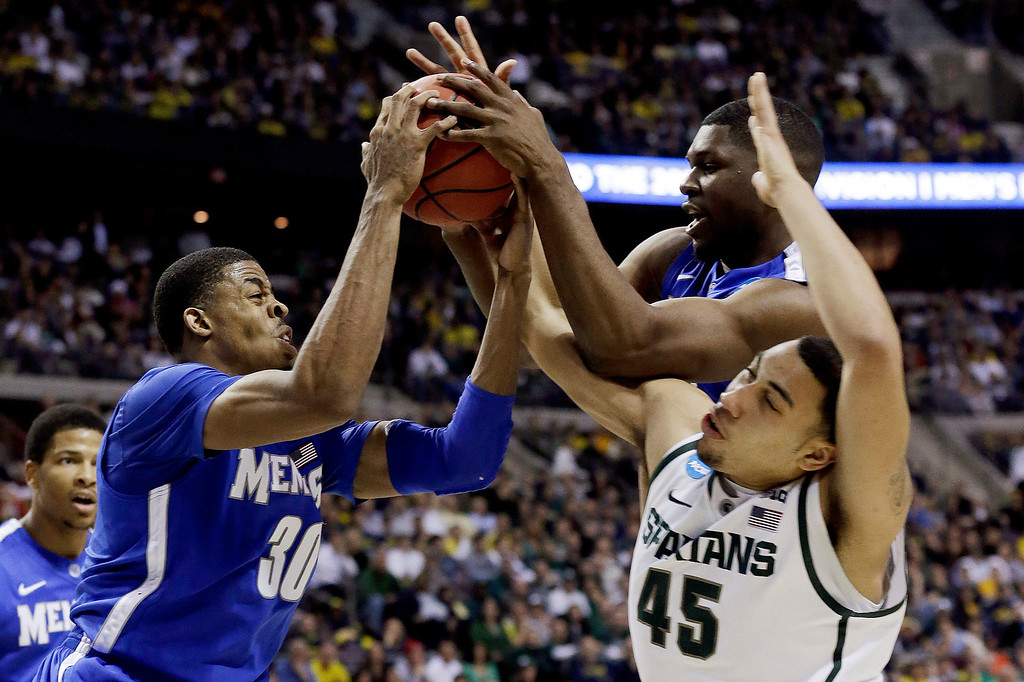 . Memphis forward D.J. Stephens (30) and Adonis Thomas  battle for a rebound with Michigan State guard Denzel Valentine (45) in the second half of their third-round game of the NCAA college basketball tournament in Auburn Hills, Mich., Saturday March 23, 2013. Michigan State won 70-48. (AP Photo/Paul Sancya)