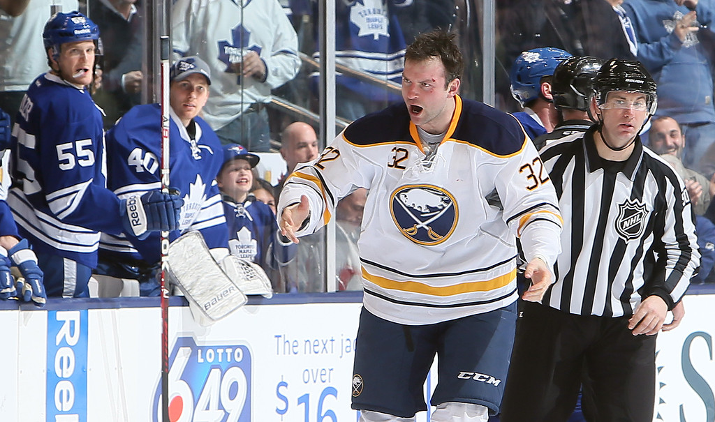 . TORONTO, CANADA - FEBRUARY 21: John Scott #32 of the Buffalo Sabres tries to pump up his team during NHL action at the Air Canada Centre February 21, 2013 in Toronto, Ontario, Canada.  (Photo by Abelimages/Getty Images)