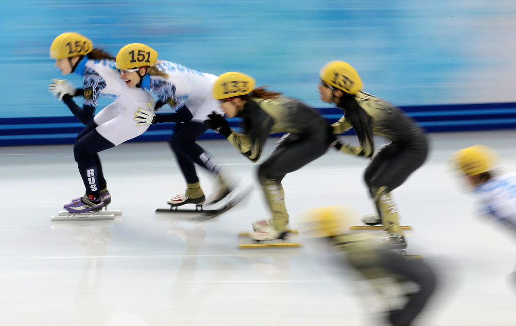 . From left, Sofia Prosvirnova of Russia, Valeriya Reznik of Russia, Sayuri Shimizu of Japan and Yui Sakai of Japan compete in the women\'s 3000m short track speedskating relay B final at the Iceberg Skating Palace during the 2014 Winter Olympics, Tuesday, Feb. 18, 2014, in Sochi, Russia. (AP Photo/Bernat Armangue)