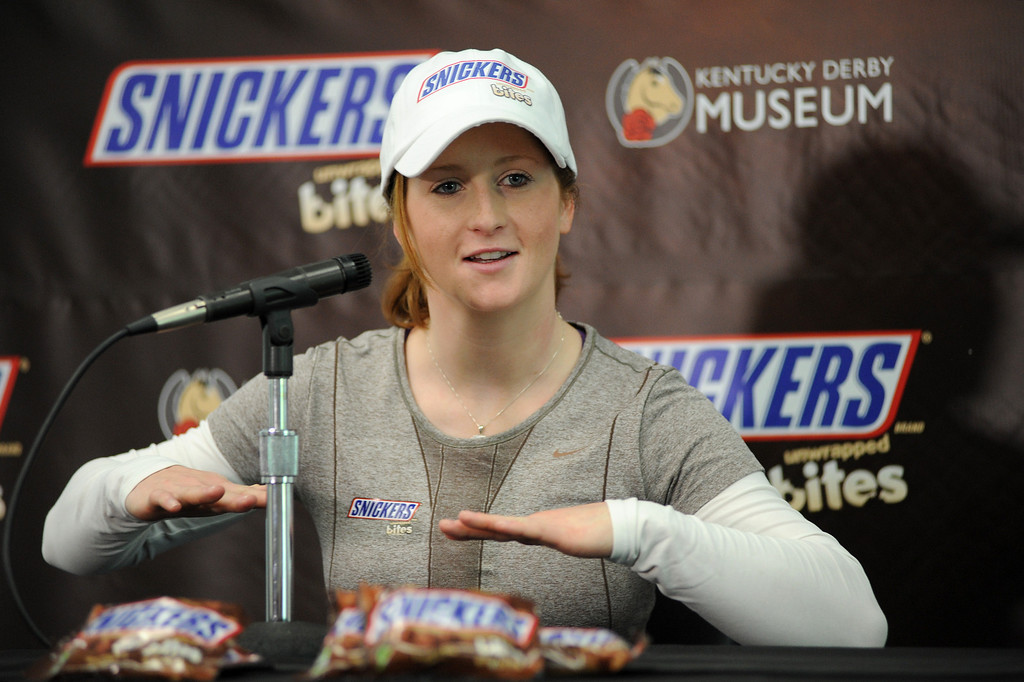. Female jockey Rosie Napravnik takes a second from racing to field questions from the media at the Kentucky Derby Museum Wednesday, May 1, 2013 in Louisville, Ky. Napravnik, 25, is trying to become the first female jockey to ever win the historic race and should she win, SNICKERS will give away 1 million of their new SNICKERS Bites for free.� (Brian Bohannon/AP Images for Mars Chocolate North America).