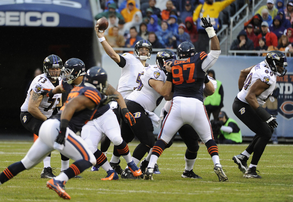 . Joe Flacco #5 of the Baltimore Ravens passes against the Chicago Bears during the first quarter on November 17, 2013 at Soldier Field in Chicago, Illinois. (Photo by David Banks/Getty Images)