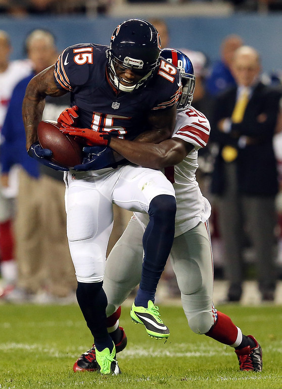 . Wide receiver Brandon Marshall #15 of the Chicago Bears is tackled by cornerback Prince Amukamara #20 of the New York Giants after a catch during a game at Soldier Field on October 10, 2013 in Chicago, Illinois.  (Photo by Jonathan Daniel/Getty Images)