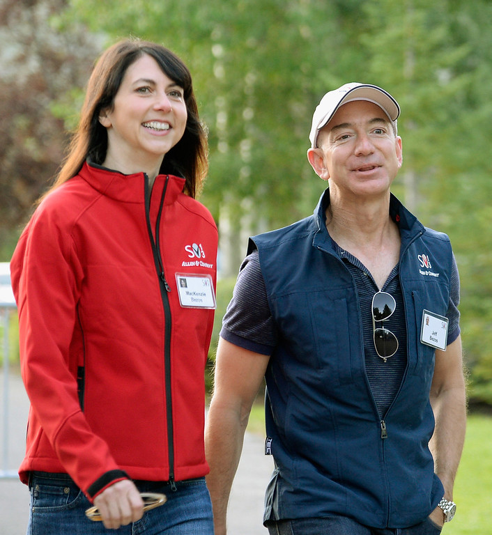 . Jeff Bezos, founder and CEO Amazon.com, and his wife Mackenzie Bezos arrive for morning session of the Allen & Co. annual conference at the Sun Valley Resort on July 10, 2013 in Sun Valley, Idaho. The resort is hosting corporate leaders for the 31st annual Allen & Co. media and technology conference where some of the wealthiest and most powerful executives in media, finance, politics and tech gather for weeklong meetings. Past attendees included Warren Buffett, Bill Gates and Mark Zuckerberg.  (Photo by Kevork Djansezian/Getty Images)