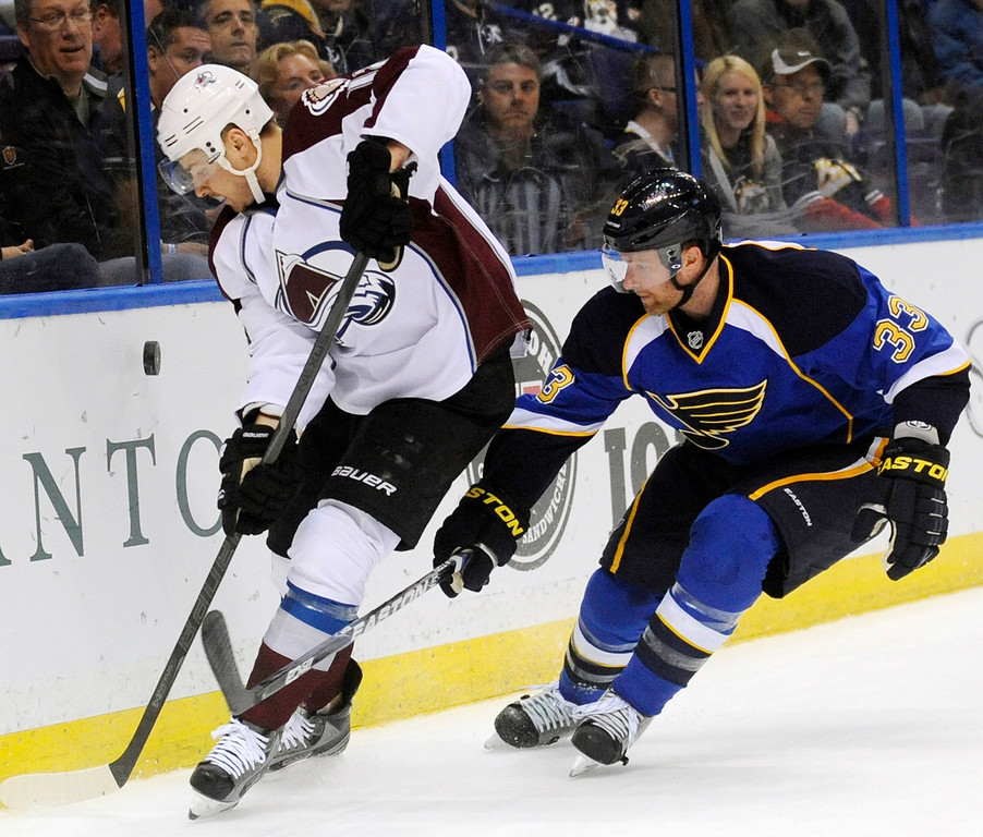 . Colorado Avalanche\'s Paul Stastny, left, gets the puck around St. Louis Blues\' Jordan Leopold (33) in the first period of an NHL hockey game Tuesday, April 23, 2013, in St. Louis. (AP Photo/Bill Boyce)