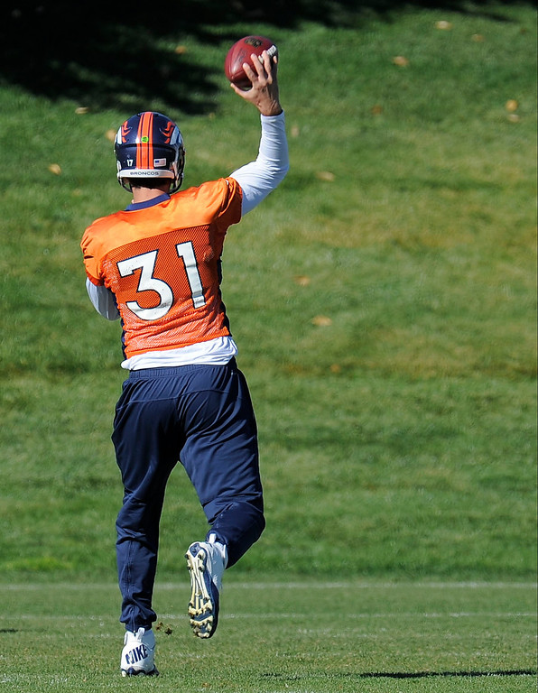 . ENGLEWOOD, CO - OCTOBER 27: Denver Broncos Brock Osweiler (17) throws a pass during practice on October 30, 2013 at Dove Valley. The players swapped jerseys for Halloween. (Photo by John Leyba/The Denver Post)