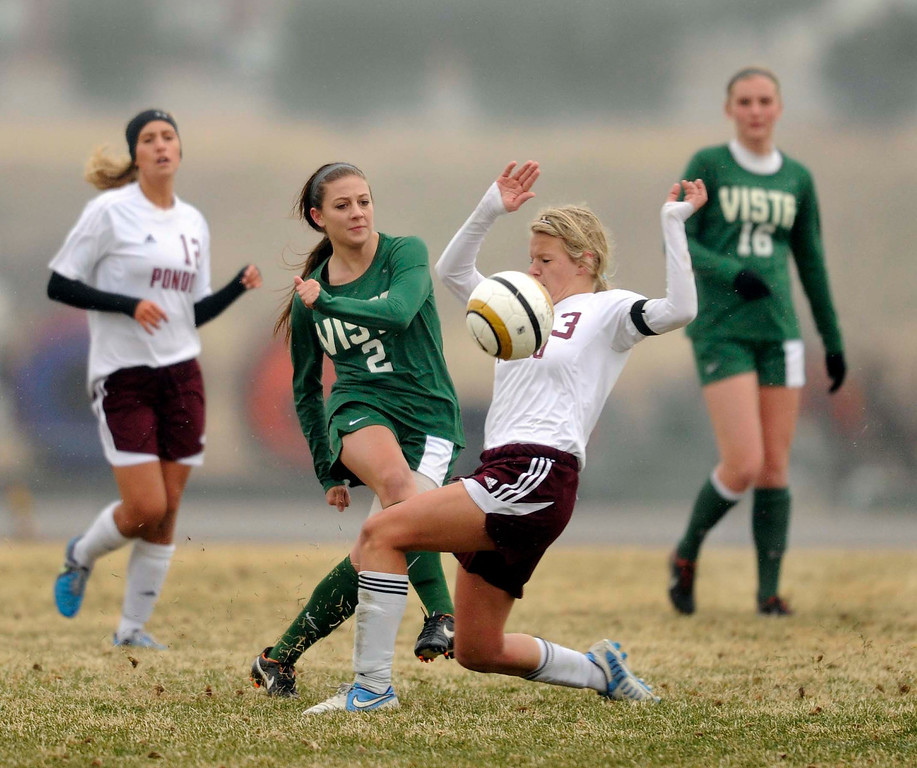 . Golden Eagle midfielder Kassidy Silva (2) took a shot past Musangs midfielder Peyton Silbaugh (13) in the second half. The Mountain Vista High School girl\'s soccer team defeated Ponderosa 6-0 Tuesday night, April 2, 2013.  Photo By Karl Gehring/The Denver Post)