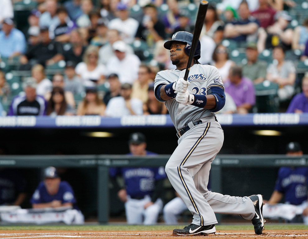 . Milwaukee Brewers\' Rickie Weeks follows the flight of his leadoff double against the Colorado Rockies in the first inning of a baseball game in Denver on Saturday, July 27, 2013. (AP Photo/David Zalubowski)