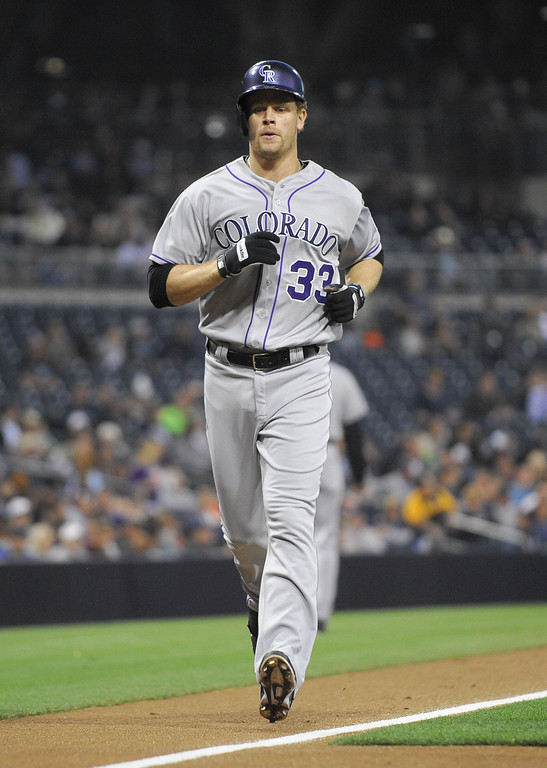 . SAN DIEGO, CA - APRIL 16:  Justin Morneau #33 of the Colorado Rockies rounds the bases after hitting a solo home run during the second inning of a  baseball game against the San Diego Padres at Petco Park April 16, 2014 in San Diego, California.  (Photo by Denis Poroy/Getty Images)
