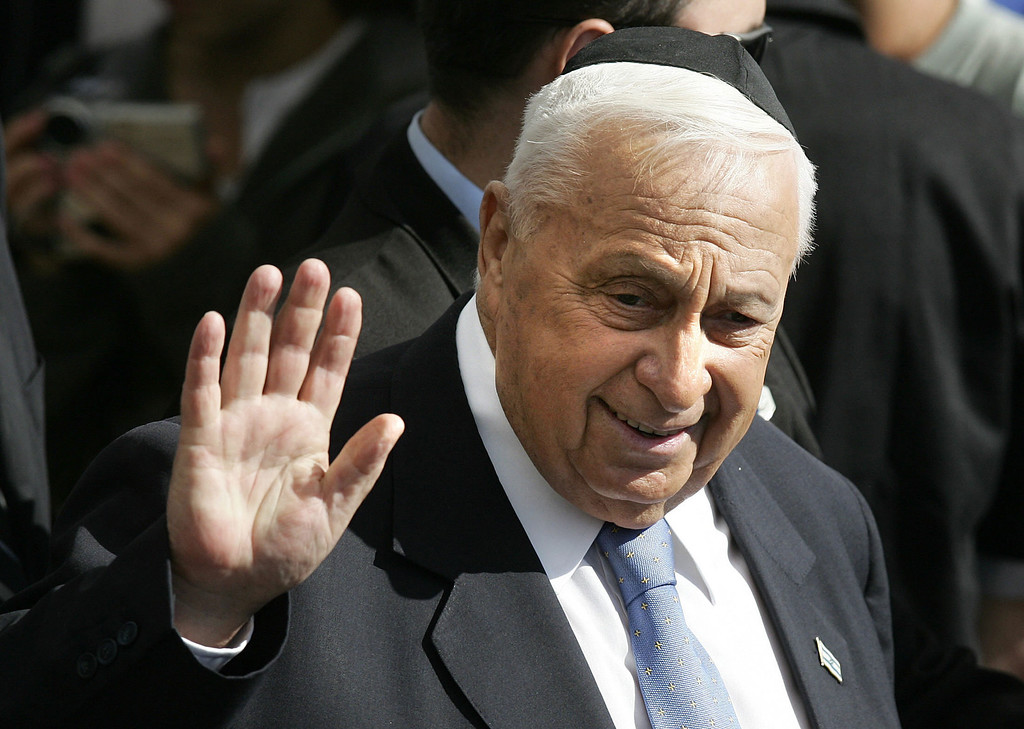 . Israeli Prime Minister Ariel Sharon waves to the audience as he arrives to participate in a memorial ceremony for Israel\'s first Prime Minister David Ben Gurion marking the 32nd anniversary for his death, in Sde Boker in the Negev desert  on December 7, 2005.  AFP PHOTO/ MENAHEM KAHANA/AFP/Getty Images