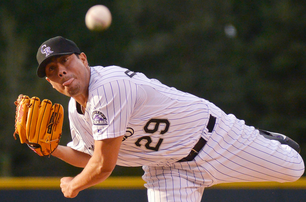 . DENVER, CO - JUNE 24: Colorado Rockies starting pitcher Jorge De La Rosa (29) delivers a pitch during the first inning against the St. Louis Cardinals June 24, 2014 at Coors Field. (Photo by John Leyba/The Denver Post)