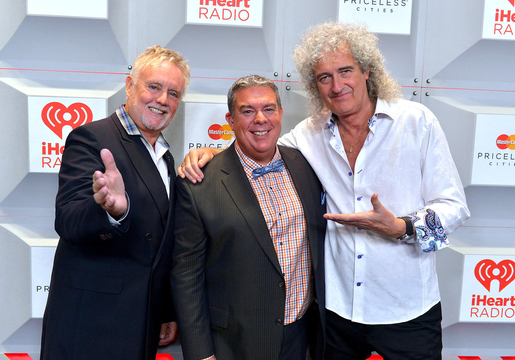 . Roger Taylor (L) and Brian May of Queen pose with Elvis Duran at the iHeartRadio Music Festival at the MGM Grand Garden Arena on September 20, 2013 in Las Vegas, Nevada.  (Photo by Bryan Steffy/Getty Images for Clear Channel)