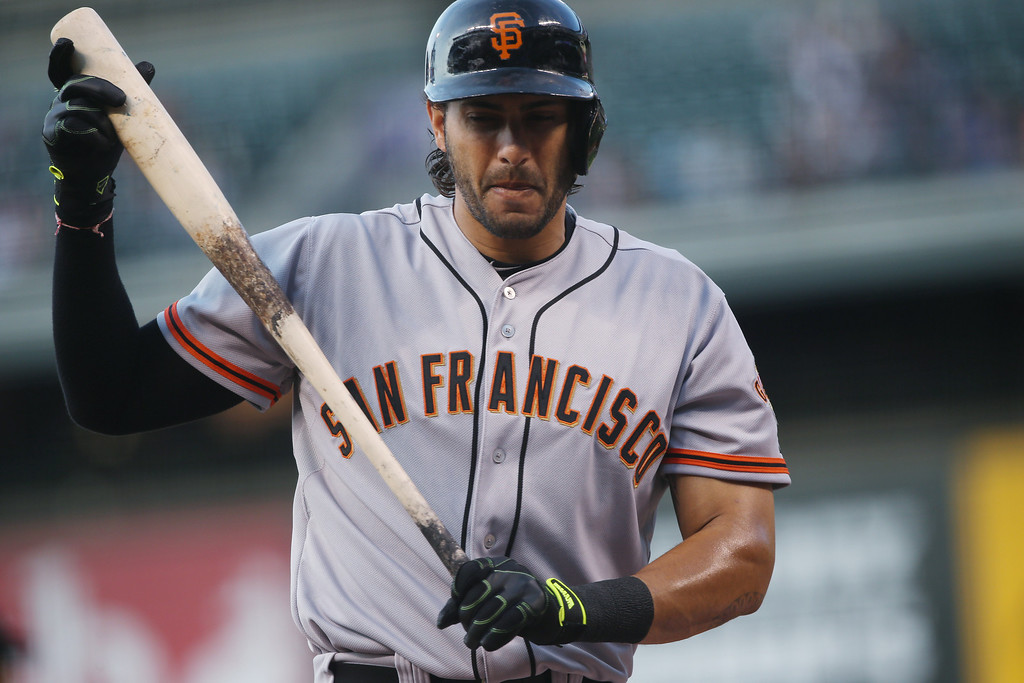 . San Francisco Giants\' Michael Morse reacts after striking out while swinging at a pitch to end the top of the first inning against the Colorado Rockies in a baseball game in Denver on Monday, April 21, 2014. (AP Photo/David Zalubowski)