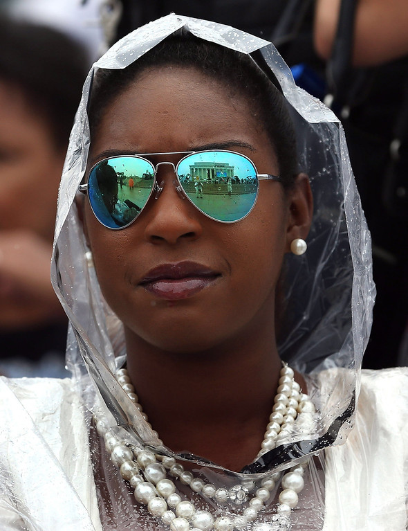 """. The Lincoln Memorial is reflected in the glasses of Christina Bostik during the \""""Let Freedom Ring\"""" ceremony to commemorate the 50th anniversary of the March on Washington for Jobs and Freedom August 28, 2013 in Washington. It was 50 years ago today that Martin Luther King, Jr. delivered his \""""I Have A Dream Speech\"""" on the steps of the Lincoln Memorial.  (Photo by Mark Wilson/Getty Images)"""