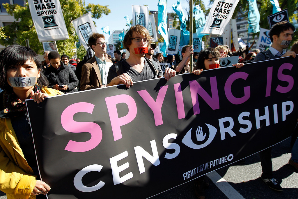 . Demonstrators March through Washington towards the National Mall to rally and demand that the U.S. Congress investigate the National Security Agency\'s mass surveillance programs Saturday, Oct. 26, 2013. ( AP Photo/Jose Luis Magana)
