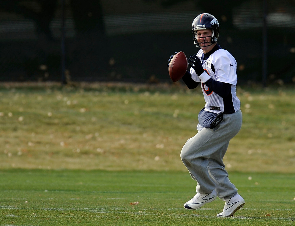 . Denver Broncos quarterback Peyton Manning (18) looks to throw down field during practice November 4, 2013 at Dove Valley (Photo by John Leyba/The Denver Post)