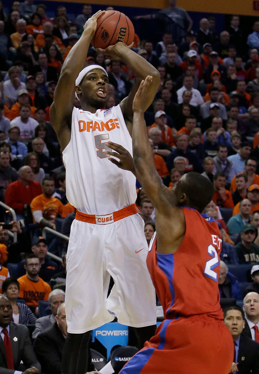 . Syracuse\'s C.J. Fair (5) shoots over Dayton\'s Jordan Sibert (24) during the first half of a third-round game in the NCAA men\'s college basketball tournament in Buffalo, N.Y., Saturday, March 22, 2014. (AP Photo/Nick LoVerde)