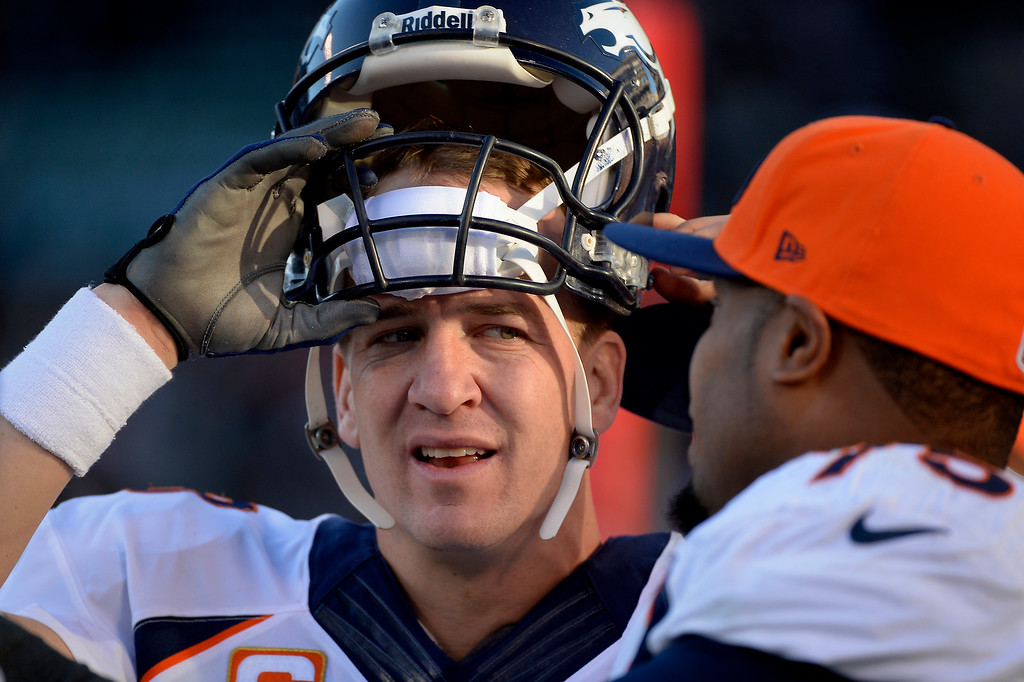 . Quarterback Peyton Manning (18) of the Denver Broncos talks with tackle Chris Clark (75) vs the Oakland Raiders at O.co Coliseum December 29, 2013 Oakland, CA. (Photo By Joe Amon/The Denver Post)