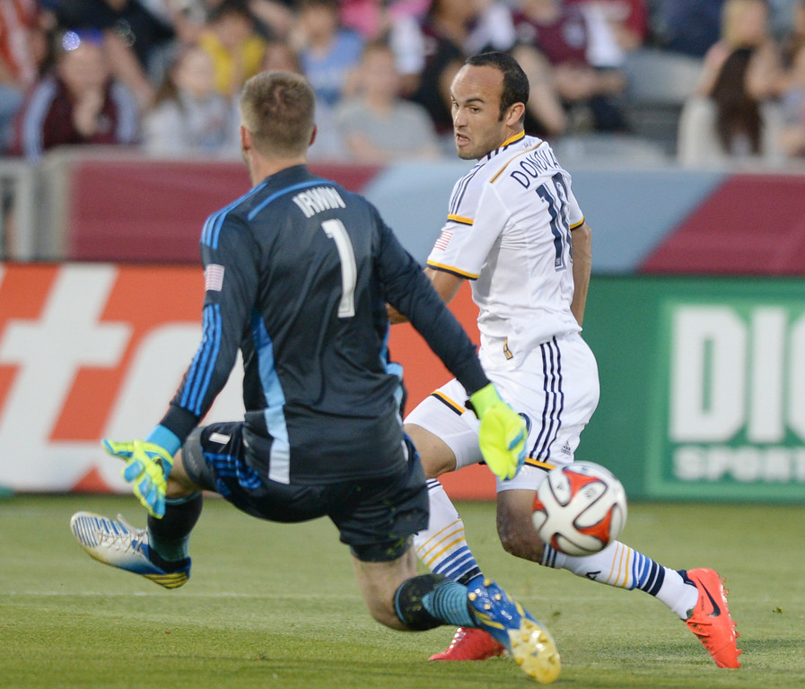 . Galaxy midfielder Landon Donovan tried to sneak a shot past an advancing Colorado goalie Clint Irwin in the first half. The Colorado Rapids hosted the Los Angeles Galaxy Saturday night, May 3, 2014 at Dick\'s Sporting Good Park. (Photo by Karl Gehring/The Denver Post)