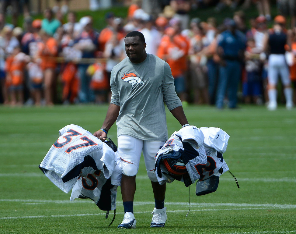 . ENGLEWOOD, CO - JULY 27: Denver Broncos rookie RB, C.J. Anderson, collects pads, jerseys and helmets after  training camp finished at Dove Valley Saturday July 26, 2013.  (Photo By Andy Cross/The Denver Post)