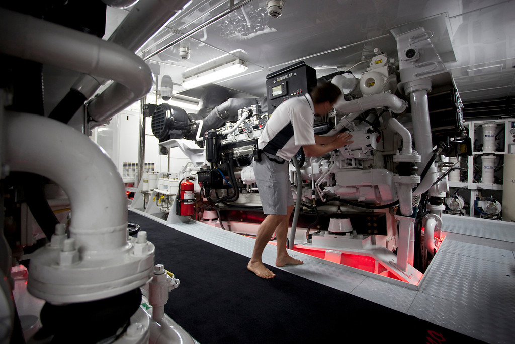 . A crew member stands beside one of the two CAT 3516C HD marine engines, manufactured by Caterpillar Inc., onboard the 190ft (57.9m) motor yacht Mi Sueno, manufactured by Trinity Yachts LLC, in Nice, France, on Wednesday, Sept. 25, 2013. Photographer: Balint Porneczi/Bloomberg