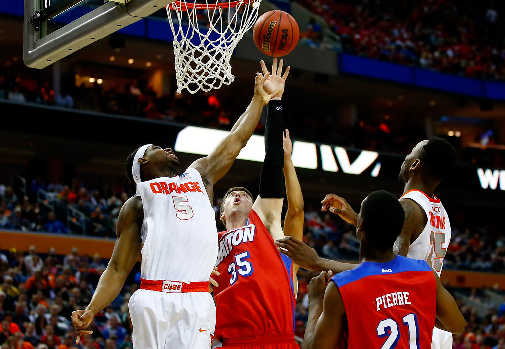 . BUFFALO, NY - MARCH 22: C.J. Fair #5 of the Syracuse Orange and Matt Kavanaugh #35 of the Dayton Flyers battle for a rebound during the third round of the 2014 NCAA Men\'s Basketball Tournament at the First Niagara Center on March 22, 2014 in Buffalo, New York.  (Photo by Jared Wickerham/Getty Images)