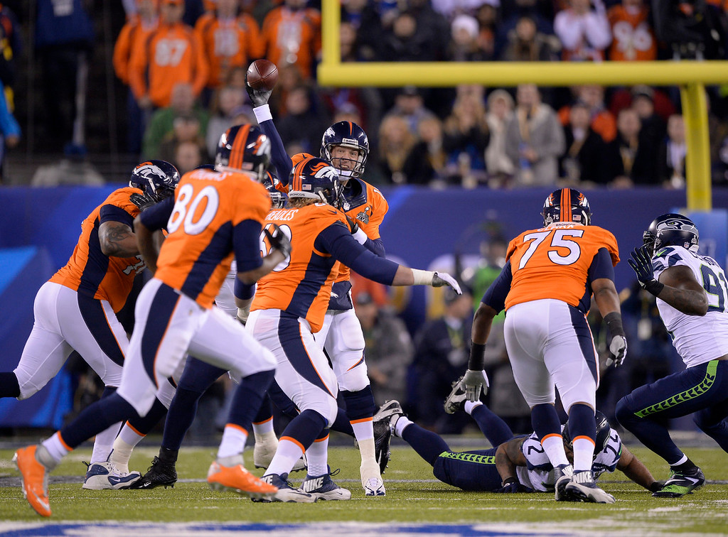 . Denver Broncos quarterback Peyton Manning (18) looks down field for Denver Broncos tight end Julius Thomas (80) during the first quarter. The Denver Broncos vs the Seattle Seahawks in Super Bowl XLVIII at MetLife Stadium in East Rutherford, New Jersey Sunday, February 2, 2014. (Photo by John Leyba/The Denver Post)
