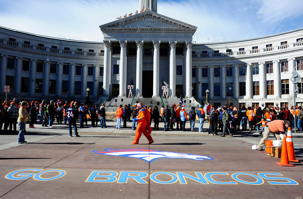 . Broncos artwork adorns Bannock Street in front of the City and County Building in Denver, Colorado, Sunday, January 26, 2014. The noon rally brought out scores of supporters and included an appearance by Governor John Hickenlooper and Denver Mayor Michael Hancock.  (Photo By Brenden Neville / Special to The Denver Post)