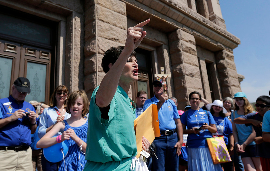 . Sen. Donna Campbell, R-New Braunfels, speaks to an anti-abortion group outside the state capitol, Monday, July 1, 2013, in Austin, Texas. The Texas Senate has convened for a new 30-day special session to take up a contentious abortion restrictions bill and other issues. (AP Photo/Eric Gay)