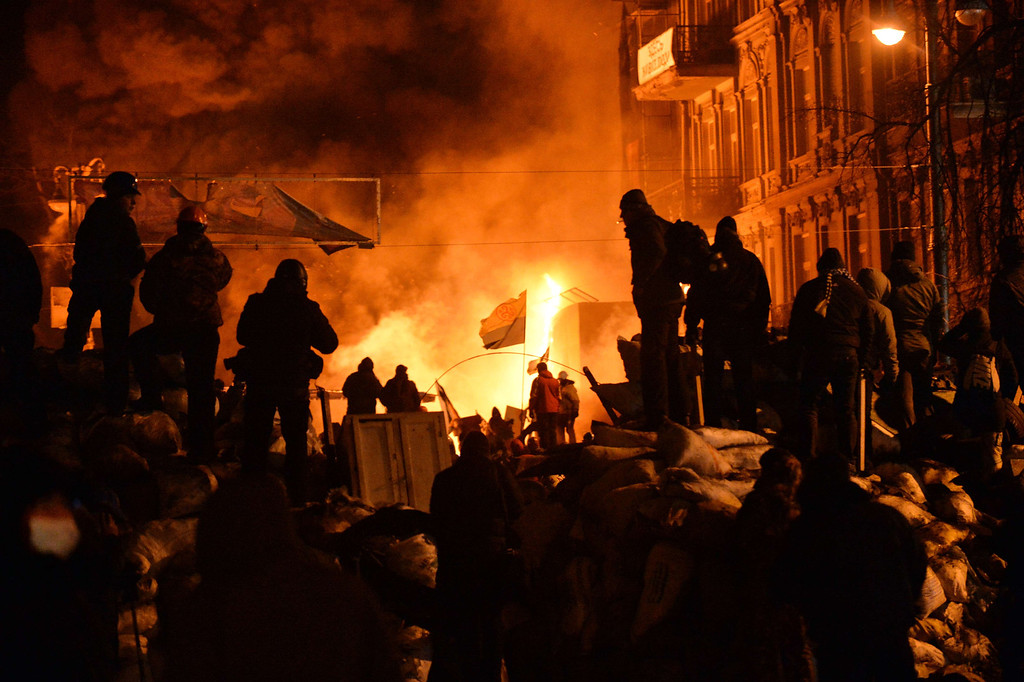 . Anti-government protesters clash with the police in the center of Ukrainian capital Kiev during the night on January 25, 2014. Violence broke out in Kiev again late Friday, with molotov cocktails flying in one direction and stun grenades in the other, but both sides stuck to their positions and the flare-up did not escalate into the running battles seen earlier in the week. AFP PHOTO/ SERGEI  SUPINSKY/AFP/Getty Images