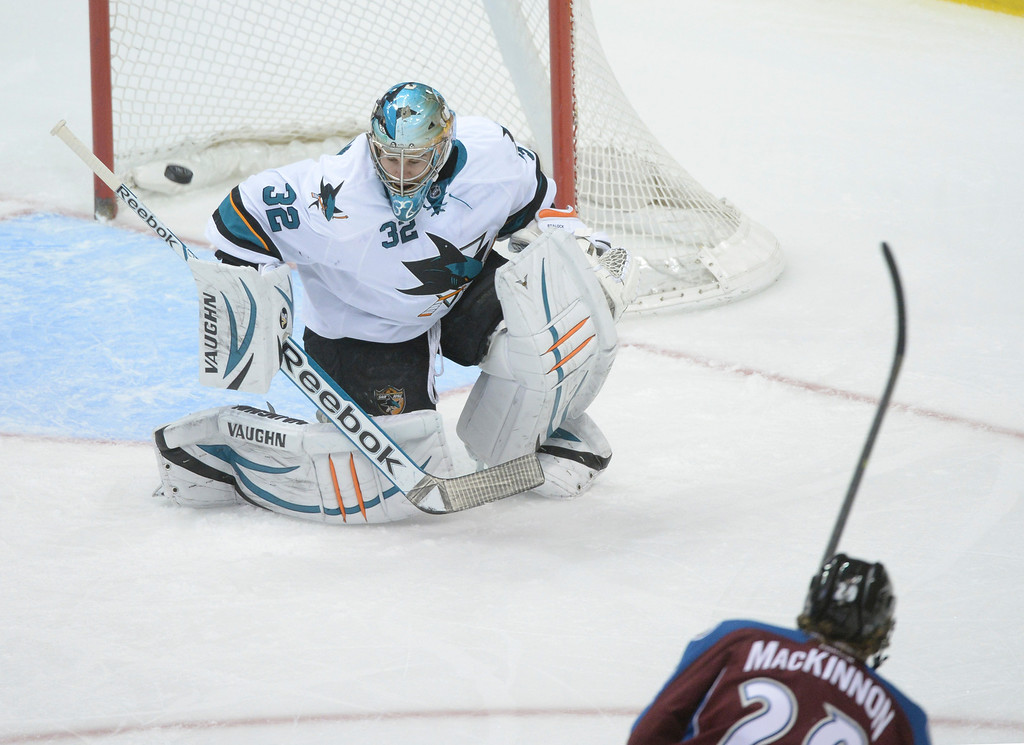. DENVER, CO. - JANUARY 04:  Avalanche center Nathan MacKinnon rifled a shot past Sharks goalie Alex Stalock in the second period. The Colorado Avalanche hosted the San Jose Sharks at the Pepsi Center Saturday afternoon, January 4, 2014. Photo By Karl Gehring/The Denver Post